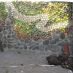 A bottle wall is a wall made out of glass bottles and binding material. A building construction style which usually uses glass bottles (although mason jars or glass jugs may be used as well… Wine Bottle Wall, Bottle House, Bottle Garden, Bottle Art, Bottle Crafts, Glass Jug, Glass Bottles, Reuse Bottles, Recycled Bottles
