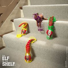 These scout elves and their Elf Pets Reindeer are taking a silly slinky ride down the stairs! How fun! | Elf on the Shelf Ideas