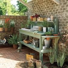 outdoor workbench - Google Search Really like this one. Sink, shelves, great green color.
