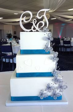 Teal & white, cascading butterfly wedding cake