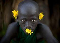 Surma boy with yellow flowers - Tulgit Omo Ethiopia by Eric Lafforgue, via Flickr