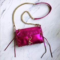 Rebecca Minkoff Mini MAC Chromatic Pink Crossbody Fantastic condition. Gently worn, very minor signs of wear on crossbody strap and interior, but none on exterior purse of hardware. Definitely gives that gorgeous POP of color! The perfect statement bag! This color is sold out everywhere. Price isn't firm, make an offer! Rebecca Minkoff Bags Crossbody Bags