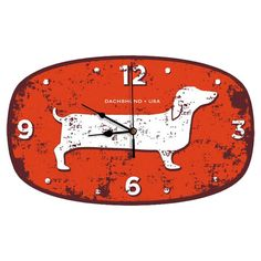 Add a charming touch of style to your home decor with this whimsical wall clock, featuring a dachshund motif and weathered orange finish.  ...