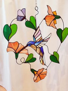 Stained glass suncatcher, glass hanger of bird, Hummingbird, Tiffany, window hanger, window art with different colors Wonderful airy and elegant hanger on wire with open background, Height is approx 40 cm, width approx 30 cm For more of these wonderful hangers please click here: