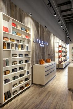 The store features exposed ceilings, a manufactured wood planks floor, and concrete-finish and metal display fixtures manufactured in Germany.