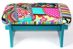 A Small stool with a patchwork cushin.