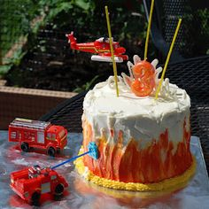 "My ""Two-step"" Fire Truck birthday cake: Step 1 - Make a cake. Step 2 - Put some fire trucks on it :)"