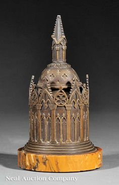 "French Bronze and Marble Desk Stand, 19th c., cast as a circular Gothic chapel with removable domed lid, on sienna marble base, height 5 1/2"". Neal Auction, Lot 965, 16 September, 2012."