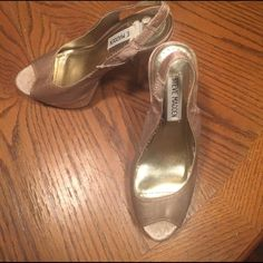 Steve Madden classy, sexy heels Satin sides with gold glittery base/platform and heel. These shoes have slip proof footing on bottom and are NWOT. They are too much of a heel for me to wear since car accident. Thank you for visiting my closet-Happy Poshing! If price is too steep just make a decent offer and I will try to accommodate.     👠 thαnkѕ Steve Madden Shoes Heels