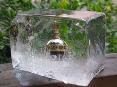 Freezing liquor bottles in ice. This could be cool stacked one on top of the other; make a backdrop for the bar!
