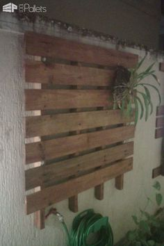 #Garden, #PalletPlanter, #RecyclingWoodPallets, #VerticalGarden Verticalplanters installed on the side wall of my house. Iused a total of 3 pallets for three planters. The two largest (120x120cm) were shelves that directly served as beds. The smaller pallet (100x100cm) is a simpler structure to hang pots and