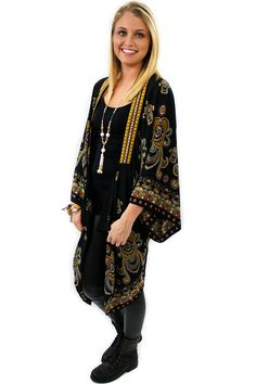 Black Print Kimono - $62.95 - Black Print Kimono with mustard and red colored embroidered hem. Just grab your favorite solid black top and black leggings or blue jeans with western boots for a truly southern style.     available at https://www.envyboutique.us/product/black-print-kimono/    #Envy #Boutique #fashion #fashiontrends