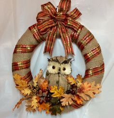 "Owl wreath. Burlap owl in the center of 16"" burlap over straw frame. Oak leaves, acorns at base. Orange, brown, green plaid ribbon and bow. by KhQualityCreations on Etsy"