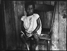 Young Girl Seated in Chair, Florida •   Walker Evans
