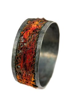 Claudia Rinneberg bracelet. Something volcanic about this, like lava and rock.
