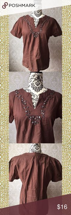 GAP boho/peasant top Chocolate brown GAP peasant top with neckline detail. The neck is notched and features pearlescent-gray smooth discs stitched on in a matching brown thread. The effect is a little like a vine. Brown button detail on sleeves (shown). I'm not sure why the picture of the back makes the shoulders look super-wide; they're not!  Very good used condition. Gap Tops Tees - Short Sleeve