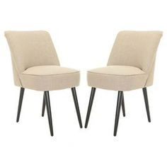 Set of two side chairs with piping detail.   Product: Set of 2 chairsConstruction Material: Birchwood, cotton, velvet and linenColor