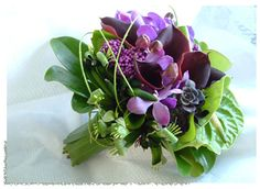 violets and greens, orchids, anthurium, kangaroo paws, wrapped in flexigrass loops