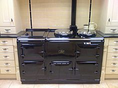 A classic black 4 oven reconditioned AGA Cooker : also available in modern deluxe models and 2 oven versions