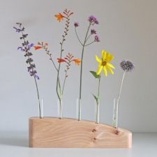 5 STEM FLOWER VASE IN ELM - A simple stylish flower stem vase hand crafted in Elm. This contemporary vase is a great way to have an exuberant display of flowers using only a few stems. I make each vase from an individual piece of wood, hand finished with natural oils to protect it and bring out the natural markings in the timber. A completely unique gift for a wedding, birthday or Christmas, or just a personal indulgence! £55.00 David Ames, Contemporary Vases, Flower Vases, Flowers, Simple Furniture, Natural Oils, Stems, Unique Gifts, Display
