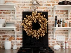 Decorate w/ Metallics! (Spray paint an inexpensive wreath). This looks great for Christmas and New Years! http://www.hgtv.com/accessories/accessorize-with-metallics/pictures/page-4.html?soc=pinterest