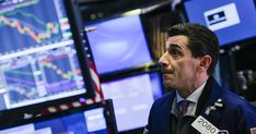 Wall Street hit by trade, rate fears