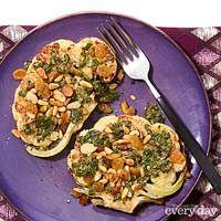 Cauliflower Steaks with Salsa Verde, Rum Raisins & Toasted Nuts