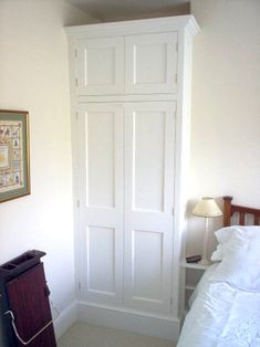 As ever the alcove beside the chimney breasts in these old houses are not deep enough to accommodate the width of a coat hanger, so wardrobe must encroach into the room slightly. Alcove Wardrobe, Bedroom Built In Wardrobe, Diy Built In Wardrobes, Fitted Wardrobes, Chimney Breast, Best Leather Sofa, Guest Bedrooms, Small Rooms, Closets