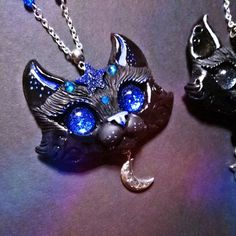 Mysterious black cat necklace by FleurDeLapin // these are so pretty