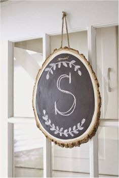 Try an easy DIY alternative to a wreath by making this hanging chalkboard wood slice.