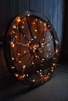 Wagon wheel covered in Christmas lights.