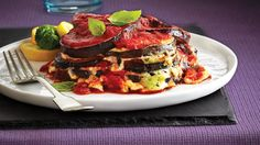A quick and easy take on eggplant Parmigiana, our version skips breading and frying the eggplant while still oozing with saucy, cheesy goodness. Try serving alongside simple tossed and steamed veggies topped with shaved Parmesan for a complete meal.