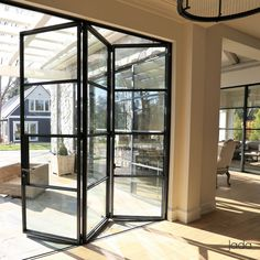 Thermally broken steel folding doors windows jada thermal break breaks and wall construction door ideas detail frames improved vs. Double Doors Interior, Interior Barn Doors, Interior Modern, Folding Patio Doors, Folding Glass Door, Folding Sliding Doors, Exterior Sliding Doors, Sliding Windows, Steel Doors And Windows