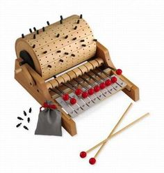 programmable music box with mallets instead of keys- the nice part is that you can also compose on the fly with hand-held mallets!