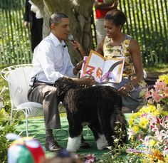 Bo walks up to U.S. President Barack Obama and First Lady Michelle Obama during a book reading at the annual Easter Egg Roll at the White House