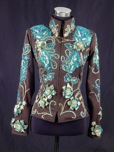 Dark brown gaberdine and teal applique jacket.  Wear this one on the rail or for showmanship.