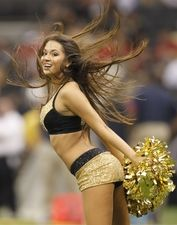 New Orleans Saintsations cheerleader performs during a timeout against the Houston Texans in the first half at the Louisiana Superdome. New Orleans defeated Houston 40-33.  #5576082