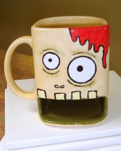 Zombie Mug  Milk and Cookies Dunk Mug by claytopia on Etsy. Or just a really cool coffee mug; totally worth having a little less space in it. So cool!