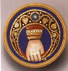 Micomosaic brooch with Hand of God designed (?) and manufacured by Castellani and Sons, Rome. Gold and glass tesserae. 1 3/16 inches. Private collection.