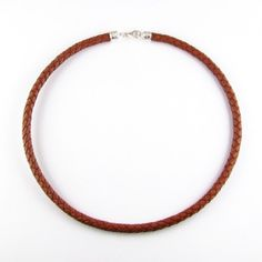 Braided leather choker necklace with ornate silver caps and lobster clasp