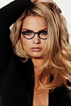Stunning picture of Margot, the glasses just enhance her beauty!!!