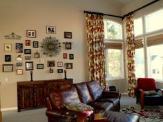 Interior Re-design by My Inside Designer. By introducing warm colors, full window treatments, and a fantastic gallery wall, the room instantly feels more personable and friendly!
