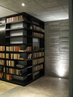 A different kind of corner bookshelf.