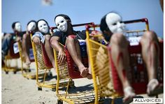 RIO DE JANEIRO, Brazil - People are posing as dead bodies at Copacabana beach in a demonstration in which a man was found dead in a shopping cart in the city slum.
