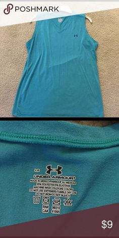 Ladies under armor tank Aqua under armor dri-fit tank. Worn once. Under Armour Tops Muscle Tees