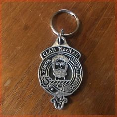 A heavy metal keyring. On one side is the clan crest, on the other is...