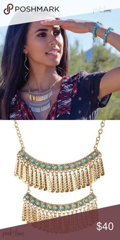 "MAYA NECKLACE MAYA NECKLACE  Both curved bar layers are embellished with simulated turquoise beads and feature swaying golden bar fringe. The bottom section may be detached to create a single row necklace. 16""+_3""ext. Park Lane Jewelry Necklaces"