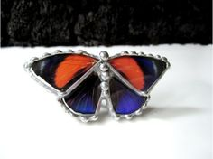 This Real Butterfly Wing Ring is made with the species Asterope markii hewitsoni $120.00