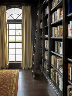 I love the extra space in the room. This prioritizes the books.........making everything else secondary!