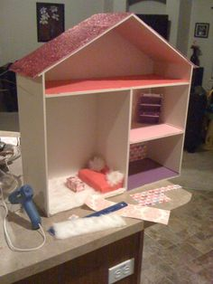 http://sheargoodiesonline.blogspot.com/2011/09/make-your-own-doll-house-customize.html    Do it yourself see my blog for instructions, on an easy super fun thing to make.     *For boys, just plop a BATMAN sticker on it, paint it blue, and customize the colors, and you have a house for all of his action figures.